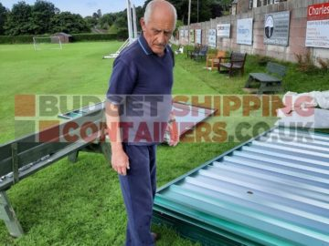 Customer picking out the next pannel to fit on their flat pack container