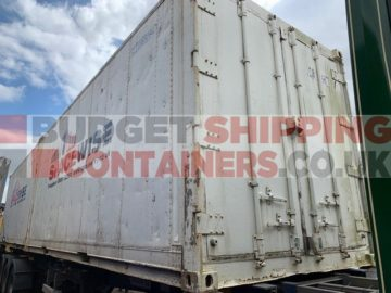 non operational refrigerated cotnianer, door and left hand side view