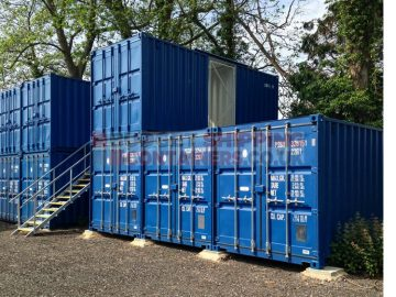 Topper Container Stacked on a standard shipping container in a self storage yard